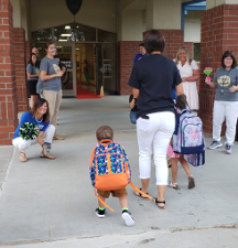 August 14, 2019 - Students are greeted by teachers on first day of school